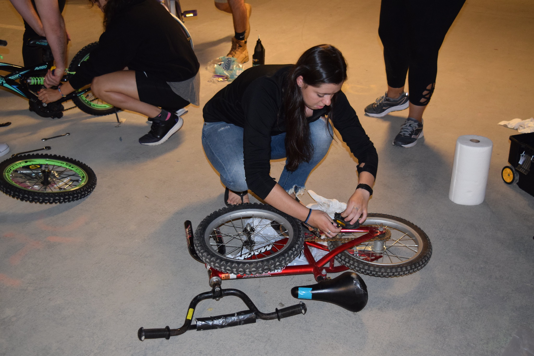 A DPT student and member of TeamGO builds a bike